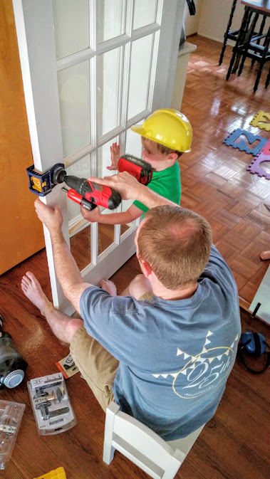 My men working on the doors Andrew got me for Mother's day!